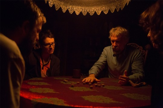 Though it may look like a game of Yahtzee, this is actually a seance.